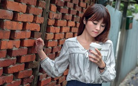 Preview wallpaper Asian girl, wall, coffee