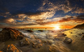 Beautiful sunset sea, stones, clouds, sun rays