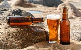 Cerveja, areias, garrafas