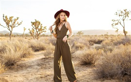 Preview wallpaper Blonde girl, jumpsuit, hat, grass