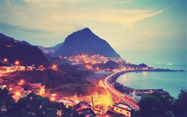 Preview wallpaper City, mountains, road, lights, sea, coast, night