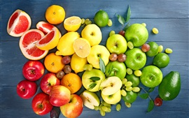 Delicious fruits, lemons, apples, grapes, oranges, yellow, green, red