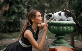 Girl and cat, face to face