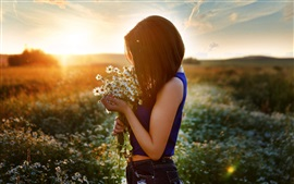 Girl and chamomile, flowers field, sunset