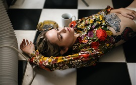 Preview wallpaper Girl lying on floor, blouse, tattoo