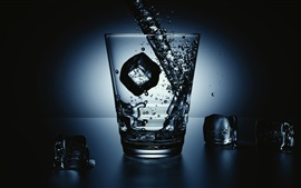 Glass cup, ice cubes, water splash