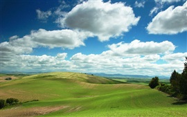 Green hills, fields, trees, clouds, sky