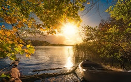 Preview wallpaper Lake, trees, boats, sun rays, autumn, morning, fog