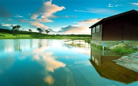 Lake, wooden house, blue sky, water reflection