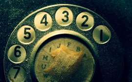 Old telephone dial, dust