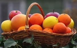 Uma cesta de frutas, maçã, limão, laranja, citrino
