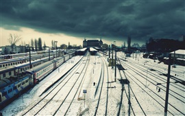 Preview wallpaper Railway station, train, wire, town, snow, winter