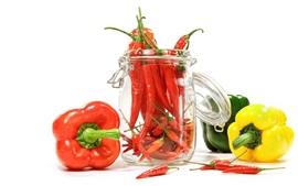Red, yellow and green peppers, white background