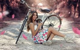Sorria garota, cachorro, bicicleta
