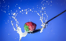 Strawberry, milk splash, spoon, blue background