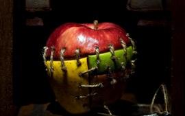 Vorschau des Hintergrundbilder Apfel, Fäden, Nähte, verschiedene Farbstücke
