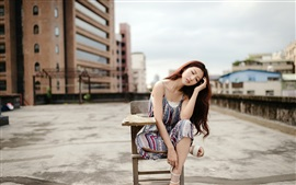 Preview wallpaper Asian girl sit on chair, roof