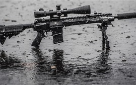 Preview wallpaper Assault rifle in rain, wet ground