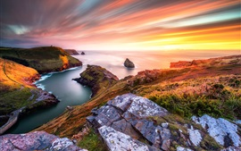 Preview wallpaper Beautiful sunset sea, slope, grass, stones