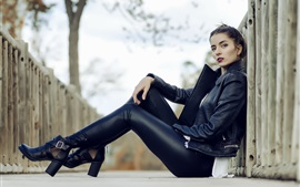 Preview wallpaper Black leather jacket girl, sit on ground