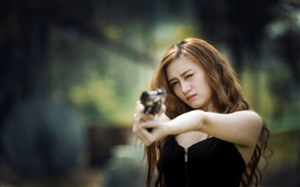 Preview wallpaper Black skirt Asian girl use gun