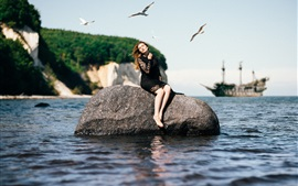 Preview wallpaper Black skirt girl sit on stone, sea, boat