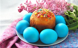 Blue Easter eggs, cake, flowers