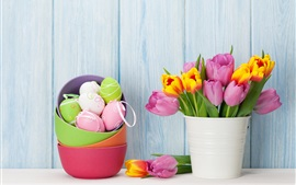 Colorful Easter eggs, pink and orange tulips