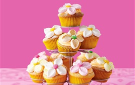 Preview wallpaper Delicious cupcakes, flowers, pink background