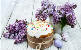 Easter cake, eggs, lilac flowers