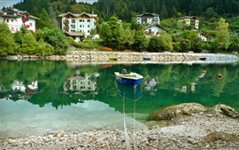 Preview wallpaper Italy, Molveno, river, boat, stones, houses
