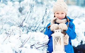Preview wallpaper Smile child girl, coat, hat, scarf, lantern, snow, winter