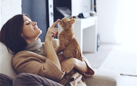 Preview wallpaper Sweater woman play with cat