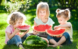 Preview wallpaper Three cute child girls eat watermelon