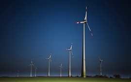 Preview wallpaper Windmills, grass, dusk