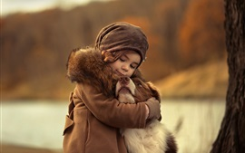 Preview wallpaper Cute child girl hug a dog