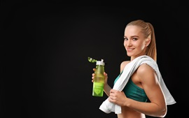 Fitness girl, smile, drink, gray background