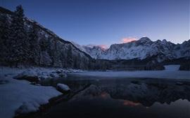 Preview wallpaper Mountains, trees, snow, lake, dusk, winter