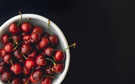 Preview wallpaper Red cherries, bowl, black background
