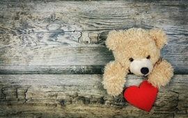 Ursinho de pelúcia, tábua de madeira, coração amoroso