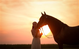 White skirt girl and horse at sunset