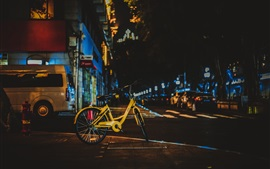 Preview wallpaper Yellow bicycle, city night, street