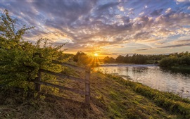 Beautiful nature landscape, fence, river, grass, clouds, sunset