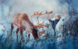 Preview wallpaper Cute child and deer in the winter