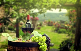 Preview wallpaper Grapes, wine, bottle, glass cups, barrel, blurry background