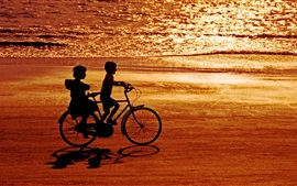 Happy childhood, childs, bike, sea, beach, sunset