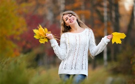 Preview wallpaper Happy girl, maple leaves in hands, autumn