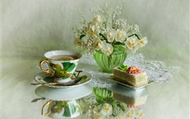 Lemon tea, daffodils, cake