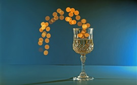 One glass cup of champagne, bright circles