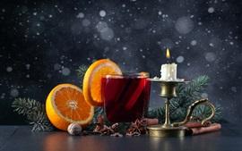 Té rojo, naranjas, vela, llama